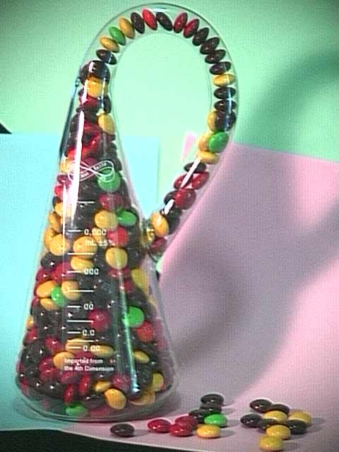 Klein Bottle filled with M&M's Candy, with calibration label