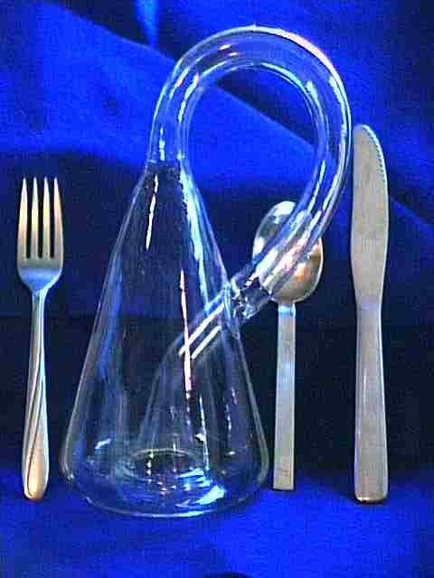 Next to a knife, fork, and spoon, here's a tasty Erlenmeyer Klein Bottle