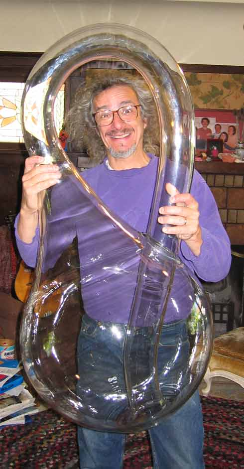 Cliff Stoll behind the meter tall Klein Bottle