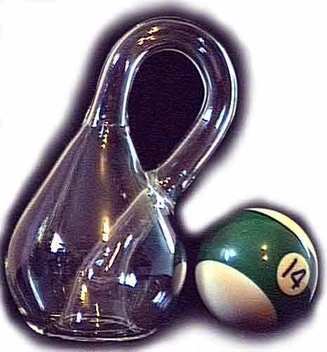 A medium size Klein Bottle next to a billiard ball